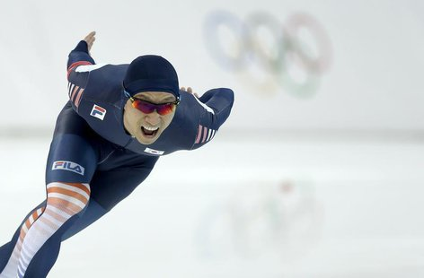 Lee Kyou-hyuk of South Korea competes in the men's 1,000 meters speed skating race during the 2014 Sochi Winter Olympics, February 12, 2014.