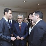 Syria's President Bashar al-Assad (L) meets with an Armenian parliamentary delegation in Damascus March 27, 2014, in this handout released b