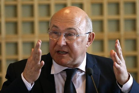 Michel Sapin, France's newly-named Finance Minister and outgoing Labour, Employment and Social Dialogue Minister, delivers a speech during t