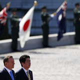 Australia's Prime Minister Tony Abbott (front L) reviews a guard of honour with Japan's Prime Minister Shinzo Abe during a welcome ceremony