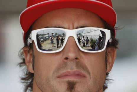Ferrari Formula One driver Fernando Alonso of Spain arrives at the paddock ahead of the Malaysian F1 Grand Prix at Sepang International Circ