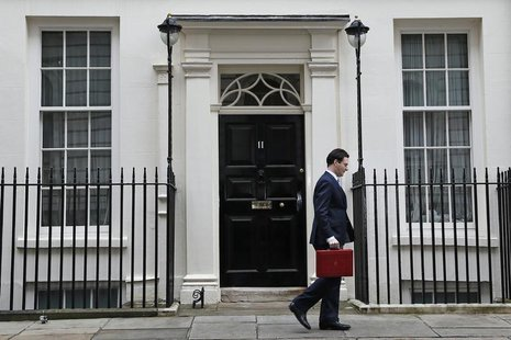 Britain's Chancellor of the Exchequer, George Osborne, walks away from number 11 Downing Street, before delivering his budget to the House o