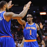 Apr 6, 2014; Miami, FL, USA; New York Knicks forward Amar'e Stoudemire (1) high fives teammate center Tyson Chandler (6) during the first ha