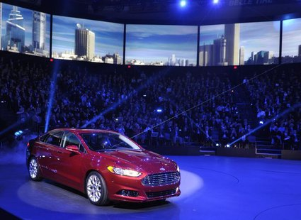 The 2013 Ford Fusion is unveiled on the first press preview day for the North American International Auto Show in Detroit, Michigan, January