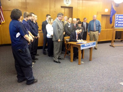 Gov. Scott Walker signs heroin-related HOPE legislation package into law in Marinette, April 7, 2014. (Photo from: FOX 11).