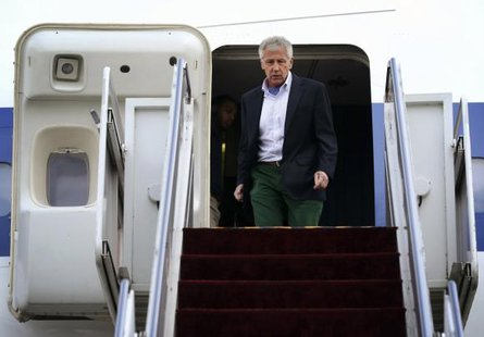 U.S. Defense Secretary Chuck Hagel walks off an aircraft upon his arrival at Yokota Air Force Base in Fussa April 5, 2014. CREDIT: REUTERS/ALEX WONG/POOL