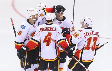 Apr 7, 2014; Newark, NJ, USA; The Calgary Flames celebrate a goal by defenseman Mark Giordano (5) during the third period against the New Je