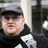 Megaupload founder Kim Dotcom talks to members of the media outside the New Zealand Court of Appeals in Wellington September 20, 2012. REUTE