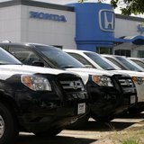 New Honda Pilot SUVs are seen at a dealership in Silver Spring, Maryland, July 1, 2008. REUTERS/Yuri Gripas