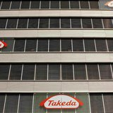 Logos of Japanese Takeda Pharmaceutical Co are seen at an office building in Glattbrugg near Zurich, in this March 7, 2012 file photo. REUTE