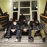 Pro-Russian protesters sit inside the seized regional administrative building in Kharkiv April 6, 2014. REUTERS/Stringer