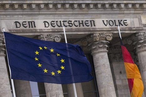 The EU flag and the German national flag fly outside the Reichstag, the seat of Germany's lower house of parliament, the Bundestag, in Berli