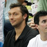 Former world champion Ian Thorpe (L) of Australia watches the swimming events at the National Aquatics Centre during the 2008 Beijing Olympi