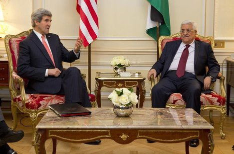 U.S. Secretary of State John Kerry (L) meets with Palestinian President Mahmoud Abbas about ongoing peace talks with Israel in Paris Februar