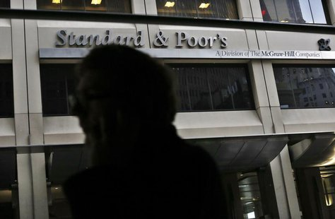A man walks past the Standard and Poor's building in New York's financial district February 5, 2013. REUTERS/Brendan McDermid