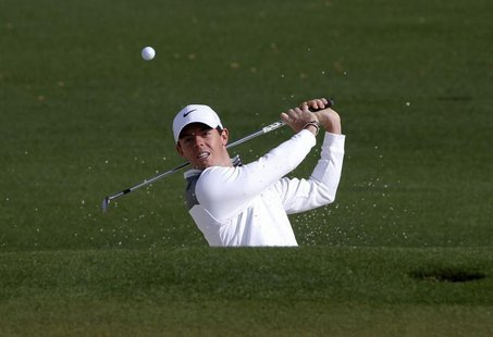 Northern Ireland's Rory McIlroy hits from the sand onto the second green during a practice round ahead of the Masters golf tournament at the