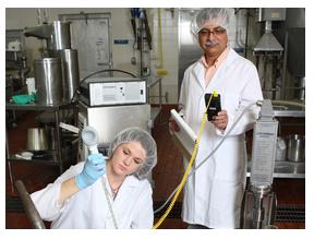 Dairy science graduate student Kim Buehner and professor Sanjev Anand work on developing a non-thermal and thermal combined application that will make heat-resistant microbes susceptible to the pasteurization process. (SDSU.edu)
