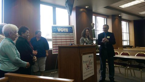 The village of Denmark wins Project VOTE's Voter Challenge trophy on April 8, 2014 at Green Bay City Hall. (Photo from: WTAQ Reporter Jeff Flynt).