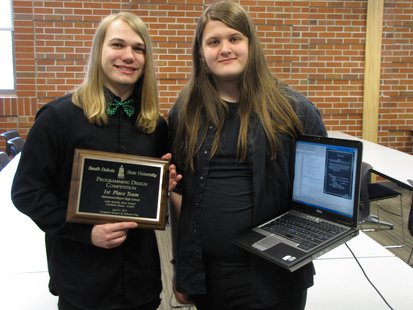 Isaac Vraspir, left, and Luke Juusola, juniors at Watertown-Mayer High School in Watertown, Minn., pose after winning the Program Design Competition at South Dakota State University April 3, 2014. The team topped 12 other entries in the 10th annual computer program contest.