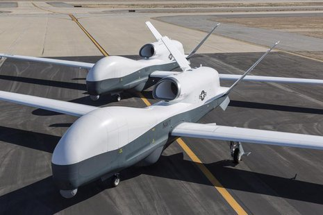 Two Northrop Grumman MQ-4C Triton unmanned aerial vehicles are seen on the tarmac at a Northrop Grumman test facility in Palmdale, Californi