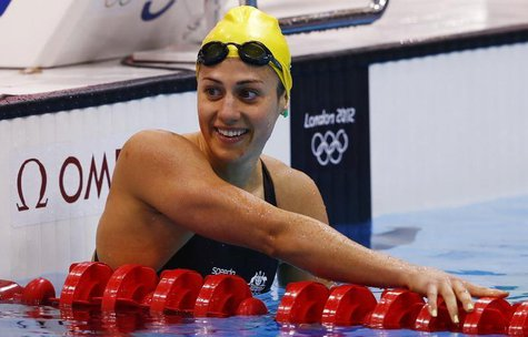 Australia's Stephanie Rice smiles after finishing in third place in heat 5 of the women's 200m individual medley event at the London 2012 Ol