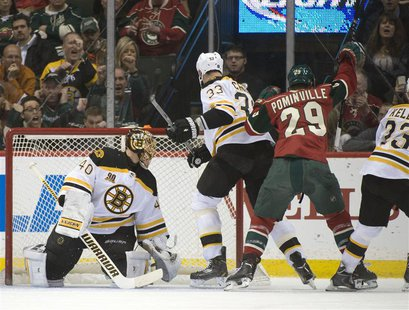 Apr 8, 2014; Saint Paul, MN, USA; Minnesota Wild right Wing Jason Pominville (29) scores his second goal of the game on Boston Bruins goalie