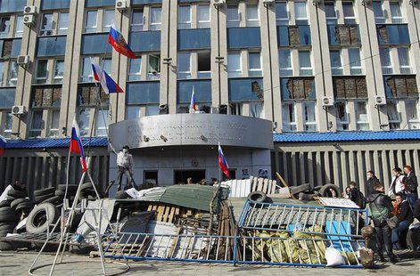 Pro-Russian protesters gather at a barricade outside the offices of the SBU state security service in Luhansk, in eastern Ukraine April 7, 2