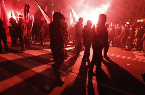 Far-right protesters walk during the annual far-right march, which coincides with Poland's National Independence Day in Warsaw November 11,