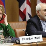 European Union foreign policy chief Catherine Ashton (L) and Iranian Foreign Minister Mohammad Javad Zarif smile at the start of talks in Vi