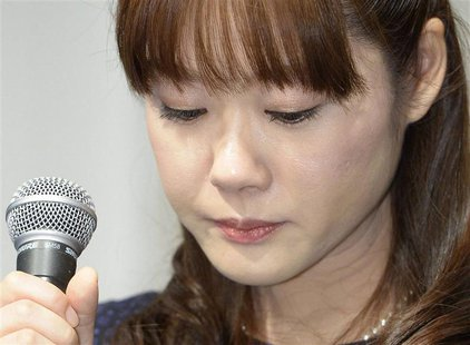 Haruko Obokata, a researcher at semi-governmental research institute RIKEN, lowers her eyes during a news conference in Osaka, western Japan