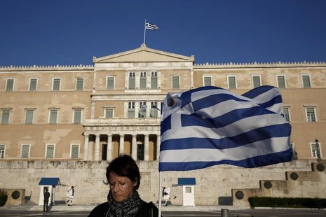 A protester stands in front of the parliament during an anti-government rally outside the parliament in Athens March 30, 2014. REUTERS/Yorgo
