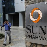 An employee speaks on phone as he walks out of research and development centre of Sun Pharmaceutical Industries Ltd in Mumbai April 7, 2014.