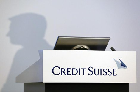 The shadow of Brady W. Dougan, CEO of Credit Suisse, is pictured before the full year results conference in Zurich February 6, 2014. REUTERS