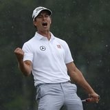 Adam Scott of Australia celebrates sinking a birdie putt on the 18th green during the final round in the 2013 Masters golf tournament at the