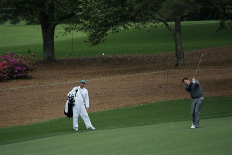 Three time champion Nick Faldo hits on the ninth fairway during a practice round before the Masters golf tournament at the Augusta National