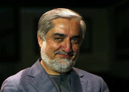 Afghan presidential candidate and former foreign minister Abdullah Abdullah smiles during an interview in Kabul April 9, 2014. REUTERS/Moham
