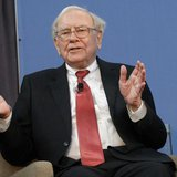 Warren Buffett, co-chair of the 10,000 Small Businesses Advisory Council, takes part in a panel discussion following a news conference annou