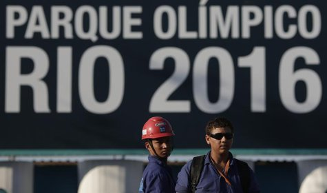 Construction workers on strike stand outside the Rio 2016 Olympic Park construction site in Rio de Janeiro April 8, 2014. REUTERS/Ricardo Mo