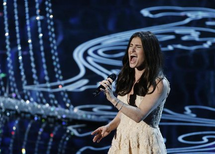 "Idina Menzel performs nominated original song ""Let it Go"" by Robert Lopez and Kristen Anderson-Lopez, for the film ""Frozen"" at the 86th Acad"