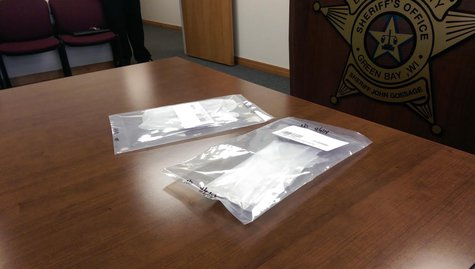 Heroin confiscated from Green Bay man arrested as a trafficking suspect on April 9, 2014. (Photo from: WTAQ Reporter Jeff Flynt.)