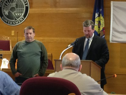 Mike Ogea is recognized by Sheboygan County Supervisor Adam Payne for his 16 years as a supervisor.