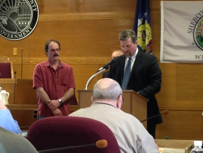 Peter Salm is recognized by Sheboygan County Administrator Adam Payne for his two years as a supervisor.