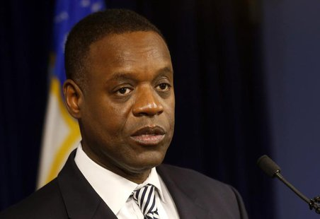 Detroit Emergency Manager Kevyn Orr addresses the media following a ruling by U.S. District Judge Steven Rhodes that Detroit is eligible for