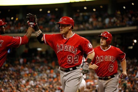 Apr 5, 2014; Houston, TX, USA; Los Angeles Angels left fielder Josh Hamilton (32) high-fives second baseman Howie Kendrick (47) after hittin