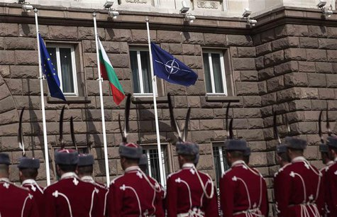 Bulgarian honour guard soldiers attend a flag-raising ceremony as part of celebrations of the 10th anniversary of Bulgaria joining NATO, in