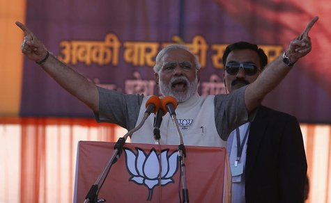 Hindu nationalist Narendra Modi, prime ministerial candidate for the main opposition Bharatiya Janata Party (BJP), gestures as he address a