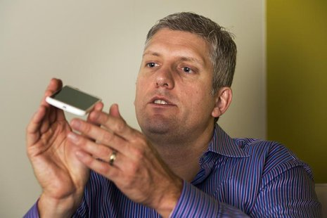 Rick Osterloh, senior vice president of product management for Motorola Mobility, describes the size of Motorola's new Moto X phone at a lau