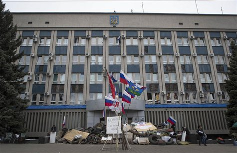 A barricade is set up in front of the seized SBU state security service in Luhansk, in eastern Ukraine April 10, 2014. REUTERS/Shamil Zhumat