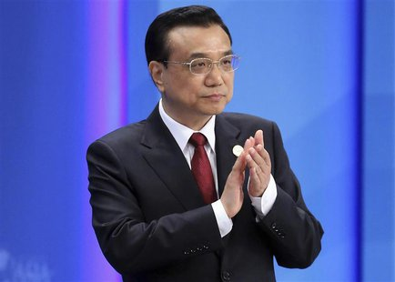Chinese Premier Li Keqiang claps as he attends the opening ceremony of the Boao Forum for Asia (BFA) Annual Conference 2014 in Boao, Hainan