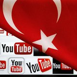 YouTube logos displayed on a laptop screen partially covered with Turkey's national flag in this photo illustration taken in Ankara March 27